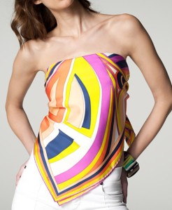 Possibly one of the most famous designers of scarves, the signature colorful geometric silk of Pucci. This is a scarf masterfully turned into a top. If you're not this daring, you can certainly tie it around your neck and pin it with a beautiful golden broach. This is a pricey accessory, but Pucci says instant class and will will never, ever go out of style.