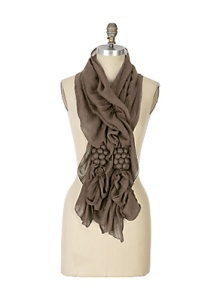 This viscose scarf can serve for warmth with your best peacoat or driving coat in fall weather. With the pom poms and ruffle-y layers in fabric, it's feminine and functional, chic and cozy.