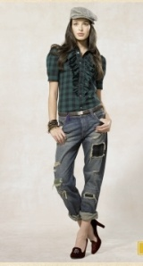 Plaid of the prepster, distressed and rolled-up jeans, proper heels, girly ruffles, and a newsboy cap. Could more styles end up in one outfit so harmoniously? Probably not.