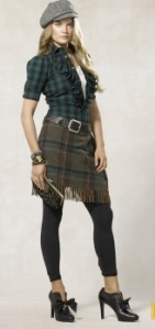 "Hello Highland-ess! This kilt makes you want to draw your dirk but the leggings and heels remind you that you're dealing with a woman. The shirred shoulders soften an otherwise classic pattern of plaid, and the hat ""tops it off"" with a funky personality."